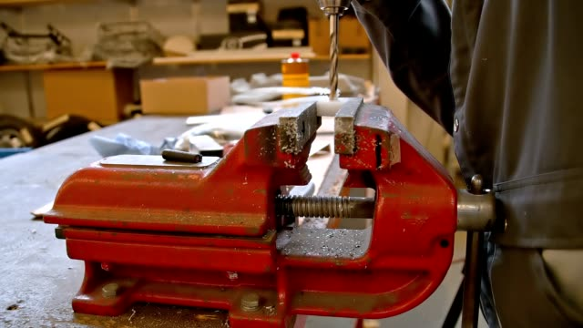 SLO MO Woodworker drilling into wood video