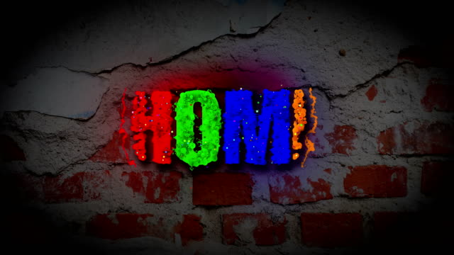 HOME word revealing on a dark brick wall video