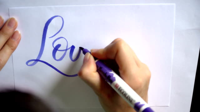 Words love story with blue ink brush calligraphy and lettering video