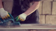 Work carpenter in the workshop. Electric Planer video
