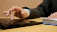 work for a laptop. kid checks information online. little hands confirm web video