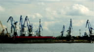 Work in the Port. Many Cranes transshipped coals of the Vessel video