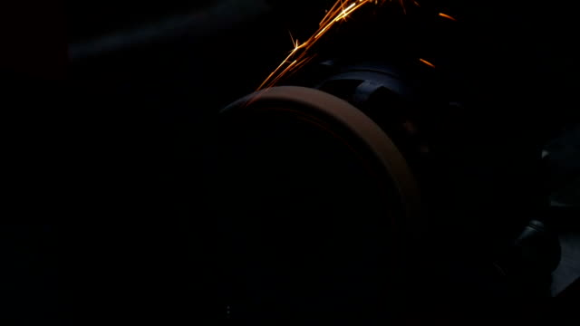 Work on a sharpening machine. In evening time Red sparks fly video