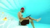 Workaholic man underwater video