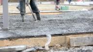 Worker aligns concrete video