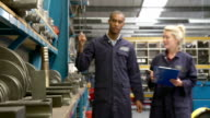 Worker And Apprentice Checking Stock Levels In Store Room video