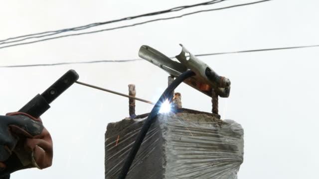 worker arc welding steel video