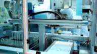 Worker at medical equipment production line video
