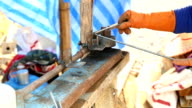worker bending steel for construction job video
