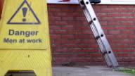 Worker climbing down the ladder video