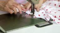 worker control sewing machine in factory video
