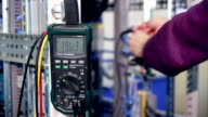 A worker controls electrical equipment on a factory with modern equipment video