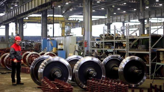 Worker controls wheels of rail vehicles video