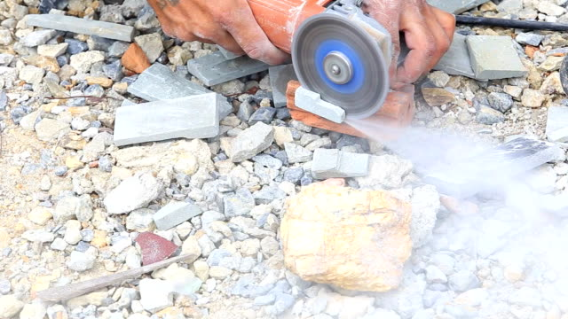worker cut stone for wall of house install video