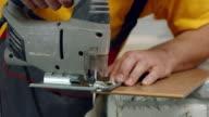 Worker cuts wood. video