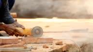 Worker Cutting Brick video