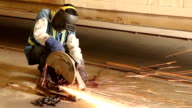 worker cutting steel. video