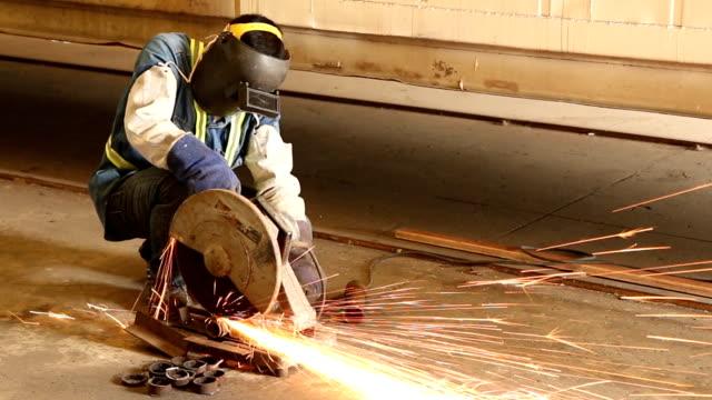 worker cutting steel. video