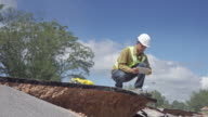 4K DOLLY : worker examing damaged road video