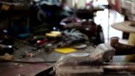 Worker grinder grinds metal in workshop video