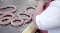 worker hands makes the sausage on the production video