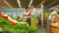 HD DOLLY: Worker Help Choossing The Right Produce video
