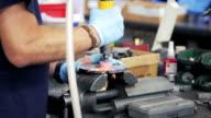 Worker in factory grinding metal video
