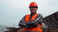 Worker in hardhat looking camera video