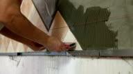 Worker installing Tiles video
