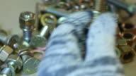 4K: Worker is screwing golden nuts video