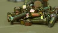 4K : Worker is screwing golden nuts video