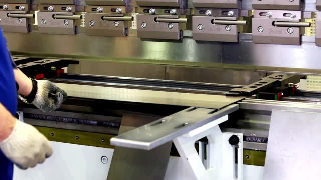 Worker is working on sheet metal bending machine video