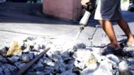 Worker man drilling cement concrete floor. video
