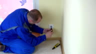 Worker man repair an electrical outlet in apartment video