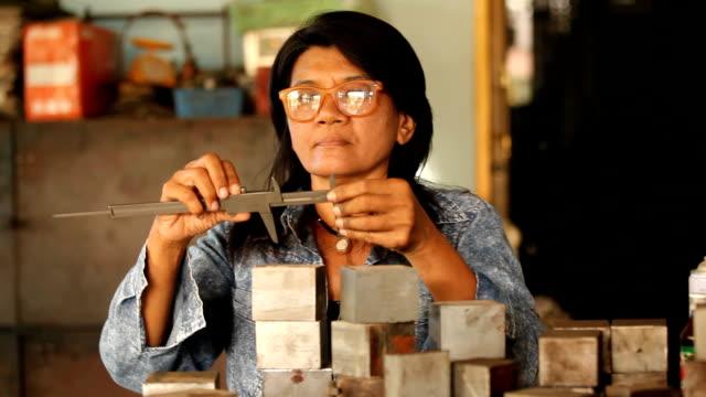 worker measuring steel video