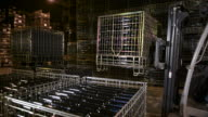 Worker moving pallets with forklift in cellar-warehouse video