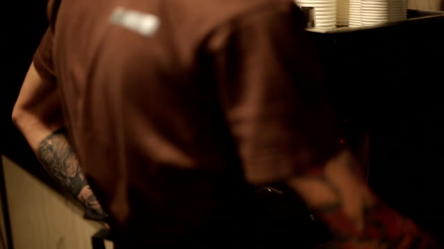 Worker of coffee shop making coffee for guests video