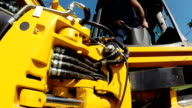 Worker Operates Heavy Machinery video