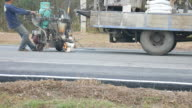 Worker painting road lines video