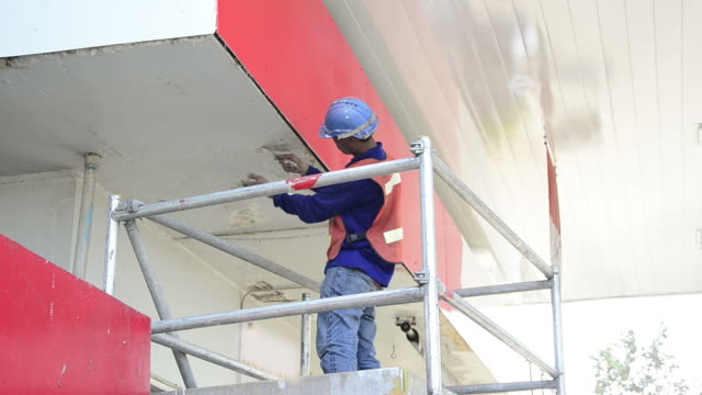 Worker Painting the Wall video