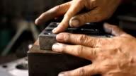 HD: Worker polishing metal. video