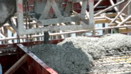 worker pouring concrete works at construction site video
