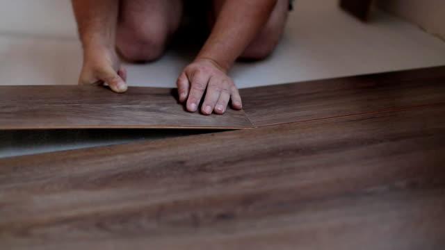 Worker puts the board flooring video