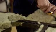 Worker puts the glass wool inside the door. video