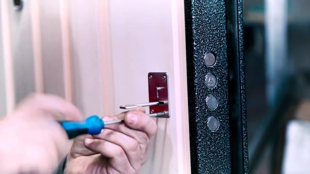 Worker setting the door lock video
