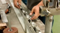 HD TILT-DOWN : Worker tighten nut video