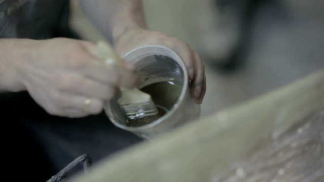 Worker to put varnish on the surface of the item video