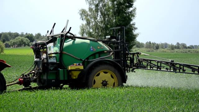 worker tractor crop video