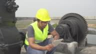 Worker using digital tablet video