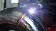 Worker welding metal exhaust pipe video